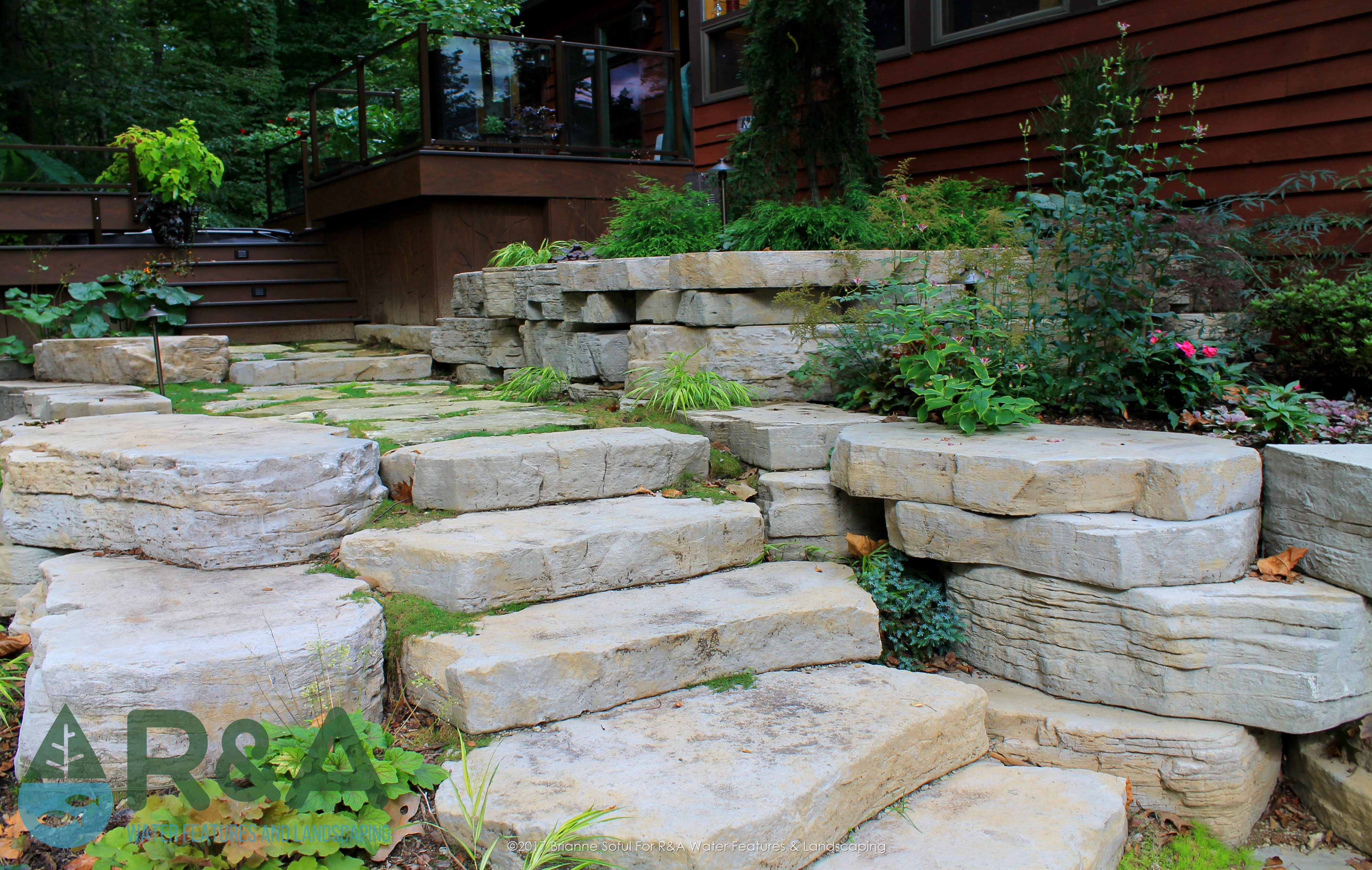 eau claire outdoor living backyard renovation of deck retaining