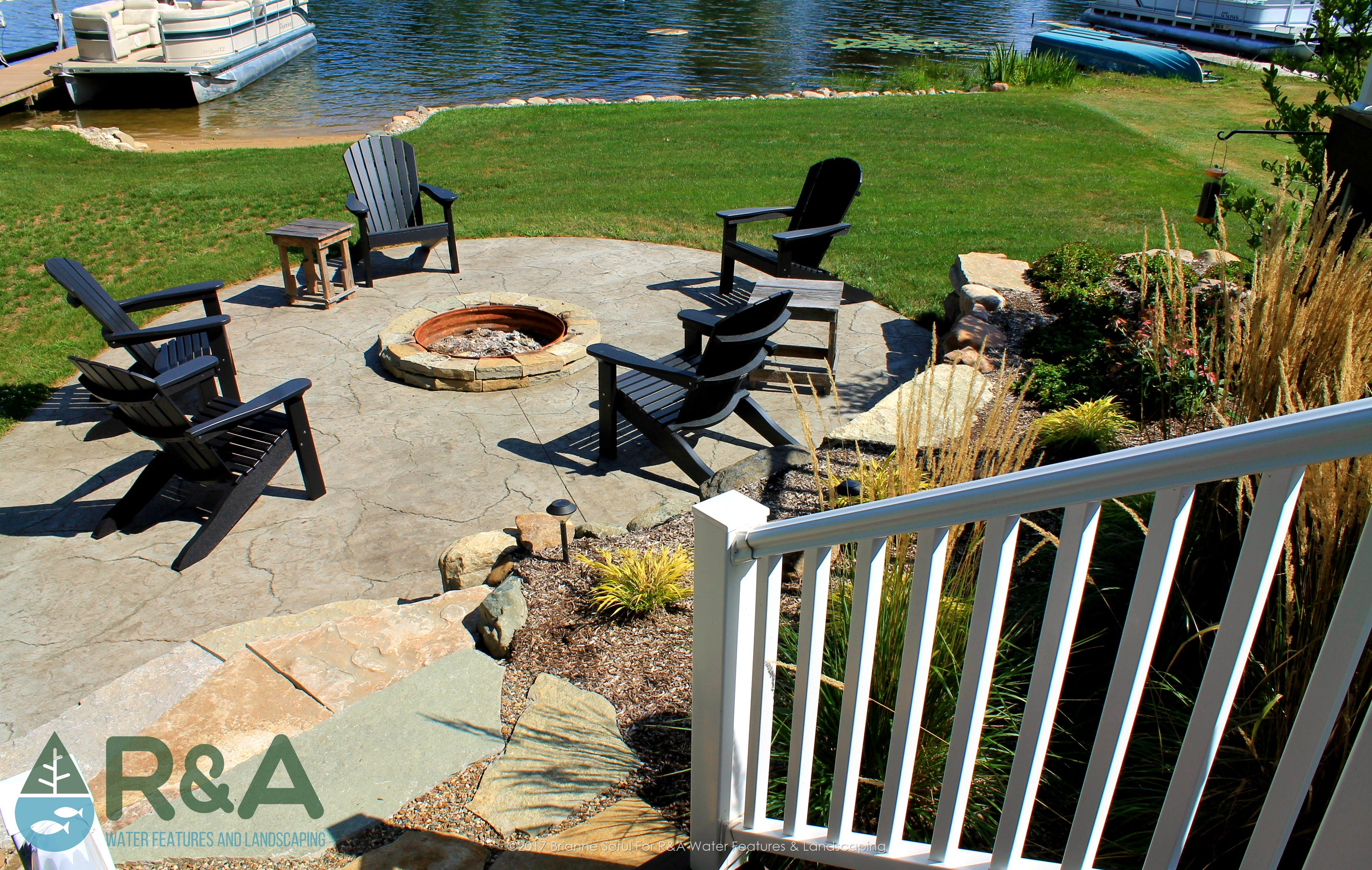 Richland Lakeside Outdoor Living Area With Fire Pit Patio Retaining Wall Deck on Pine Lake