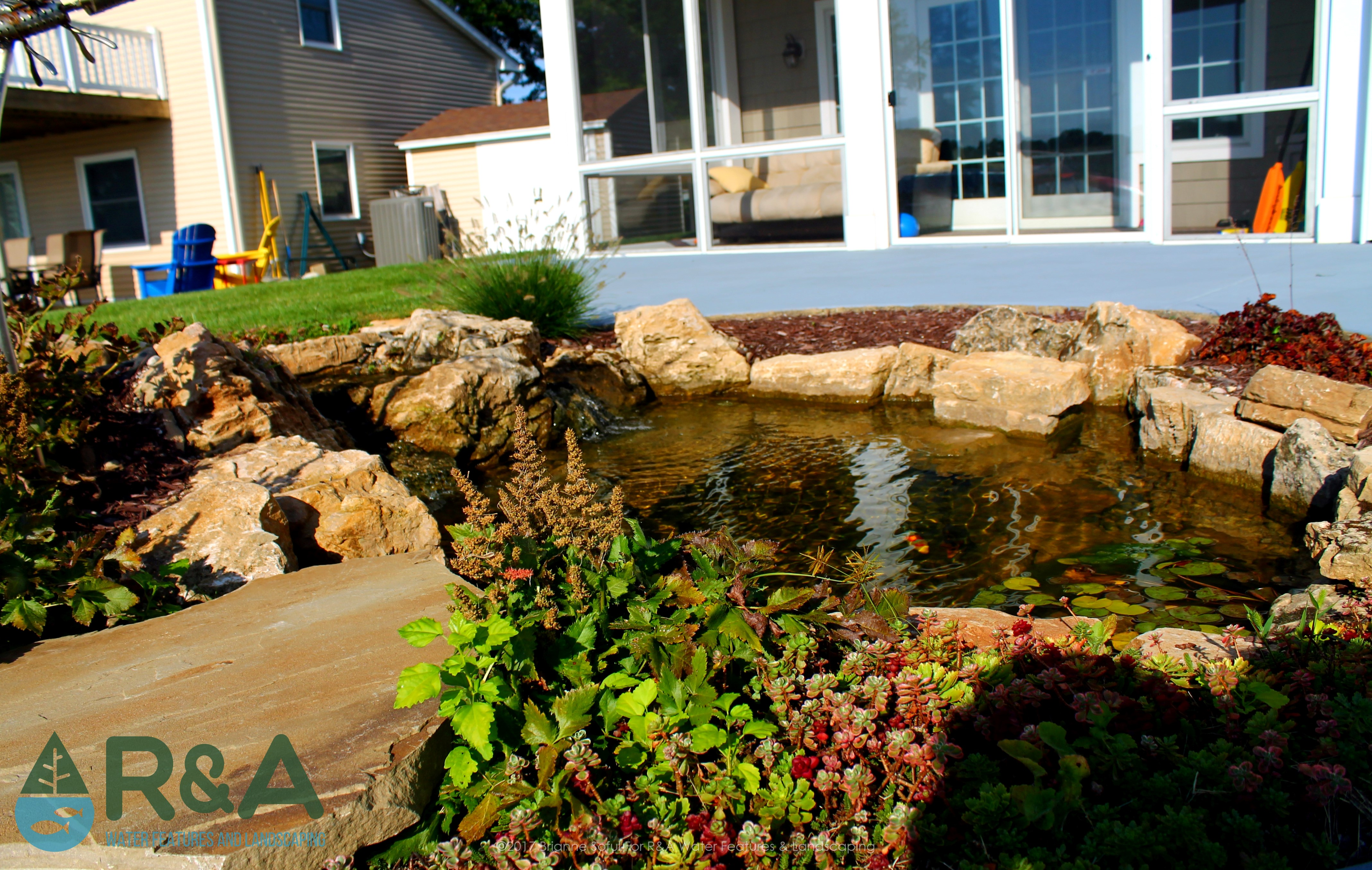 Small Koi Pond With Fish Cave Construction On Eagle Lake In Mattawan