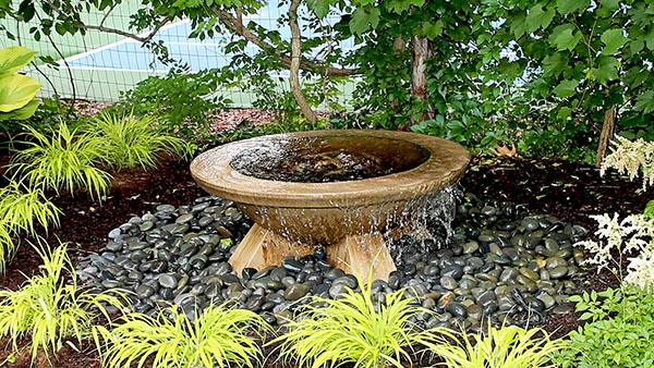 Fire pit in outdoor water fountain Grand Rapids
