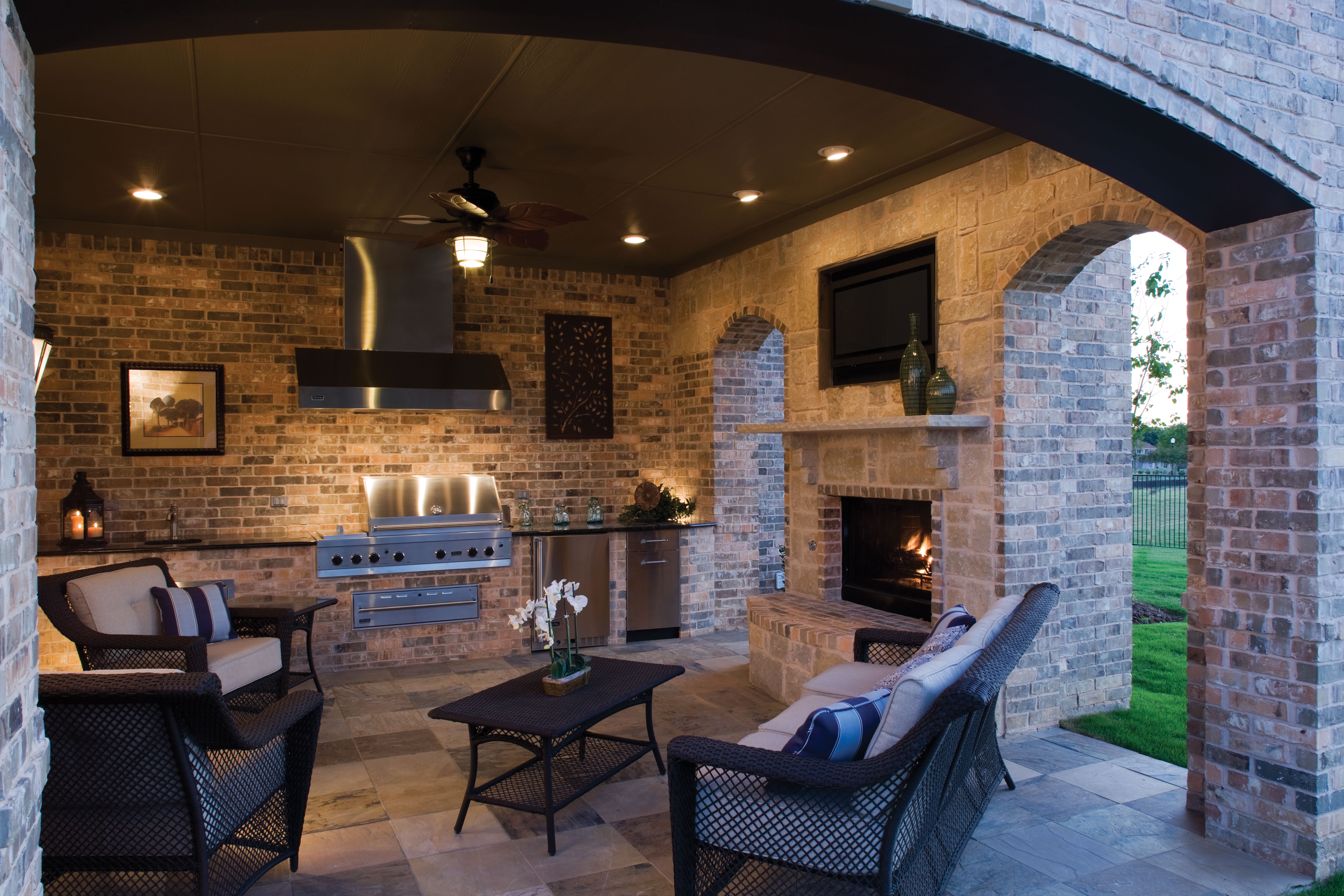 outdoor living area-kitchen-fireplace-tv-covered patio-kalamazoo-grand rapids