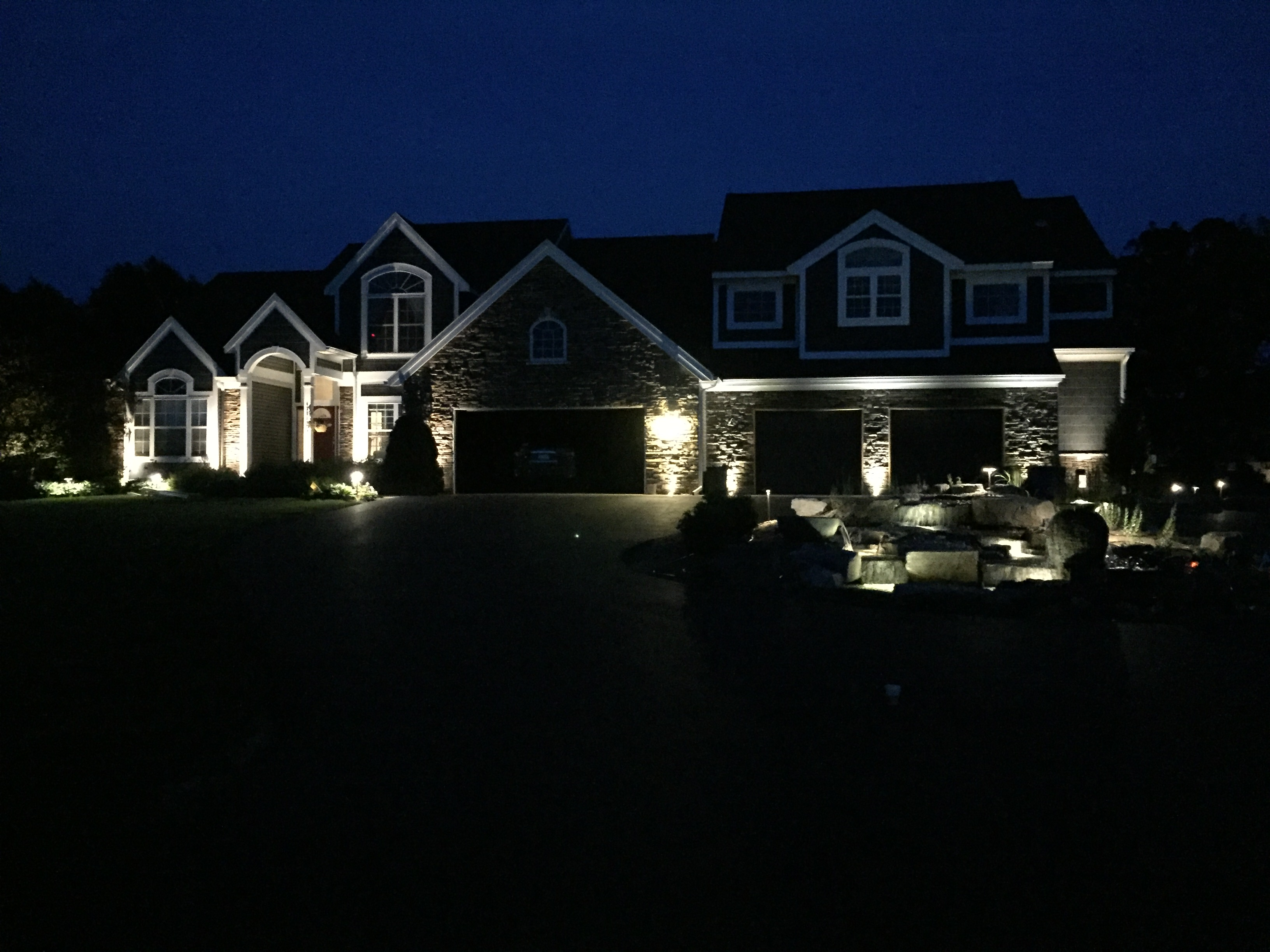 Pondless waterfall and landscape lighting project ada mi grand rapids kalamazoo