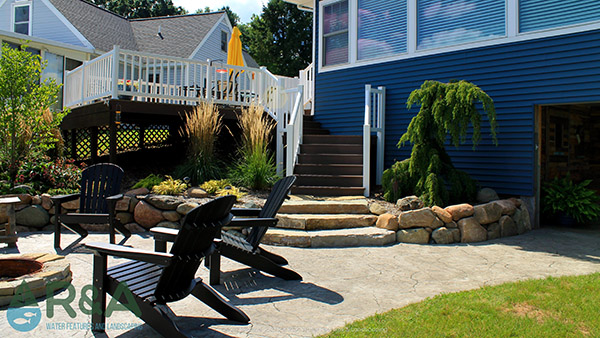 Patio with firepit and staircase in southern michigan